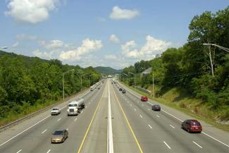 Vehicles and semi-trucks driving on an interstate